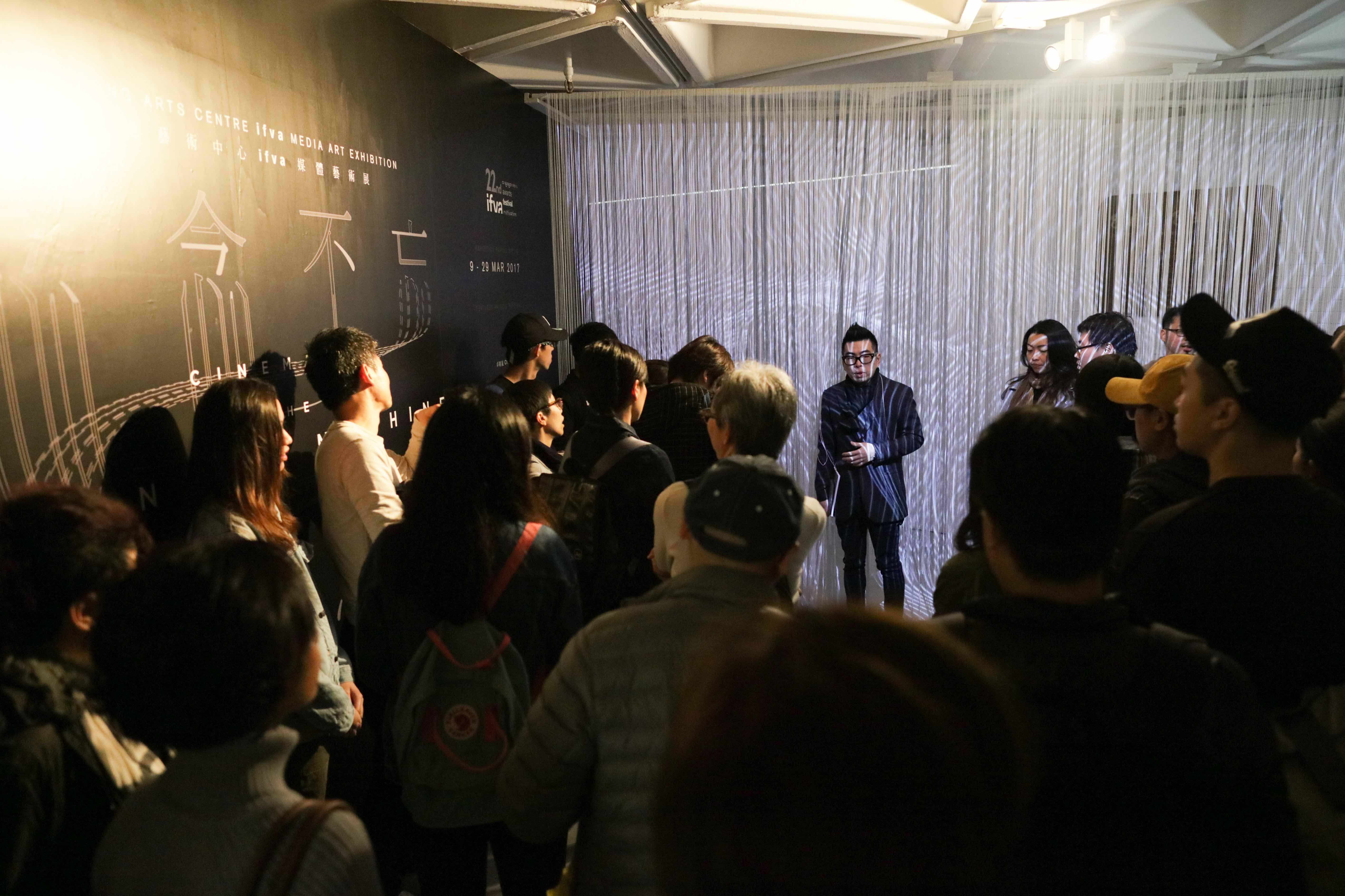 Curator Ip Yuk-yiu led the guided tour and shared with visitors his curatorial concepts.