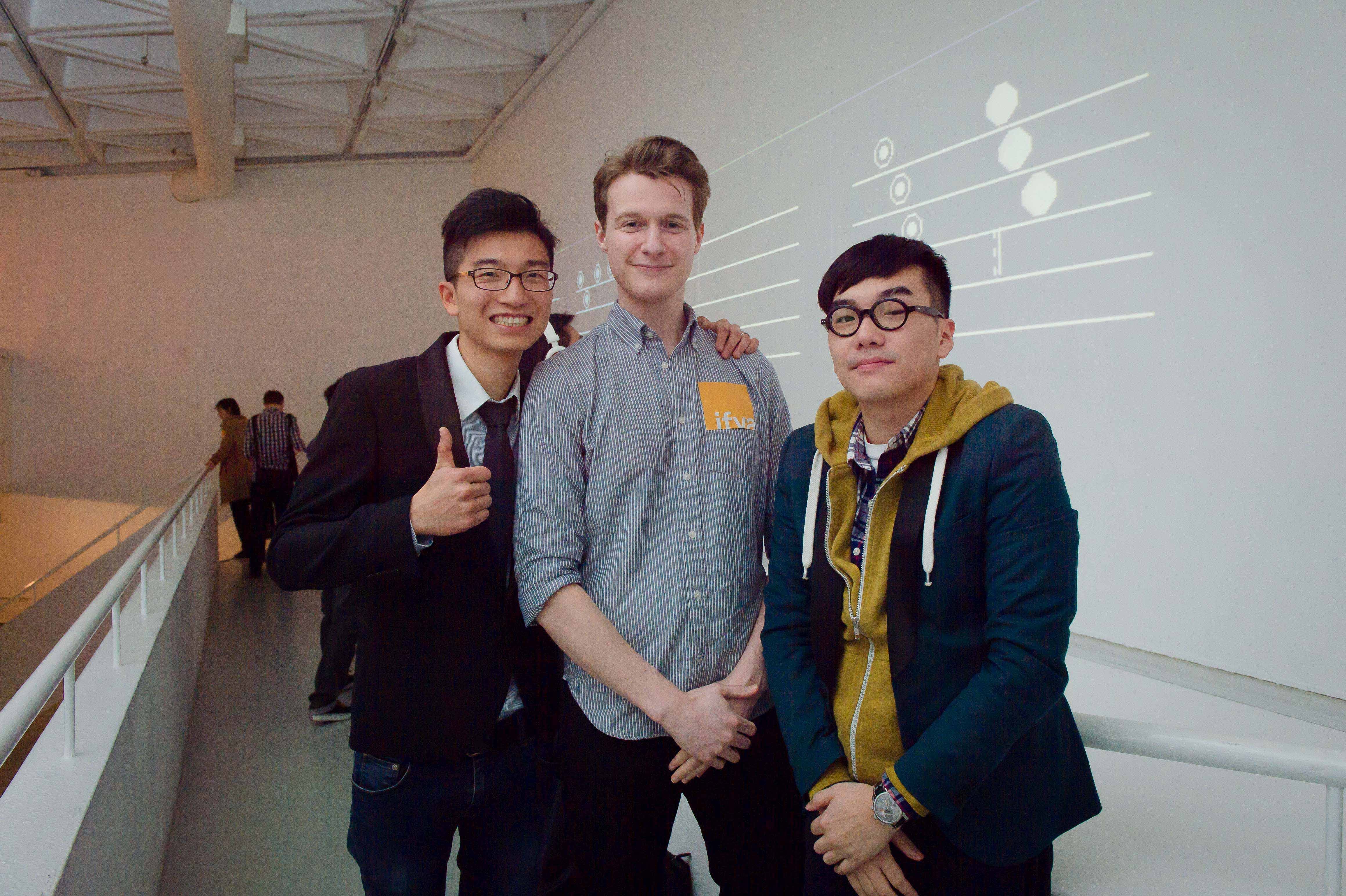 Tabor Robak took picture with Jeff Chow and Ivan Leung, the ifva finalists in front of their work, <i>Idea of Amplitude</i>.